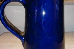 Højde 23 cm Pottemagerstuen Graabrødre Torv Flot blå glasur Kr. 450,00